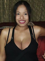 Busty Thai slut with a beautiful smile and huge boobs sucks and tit fucks